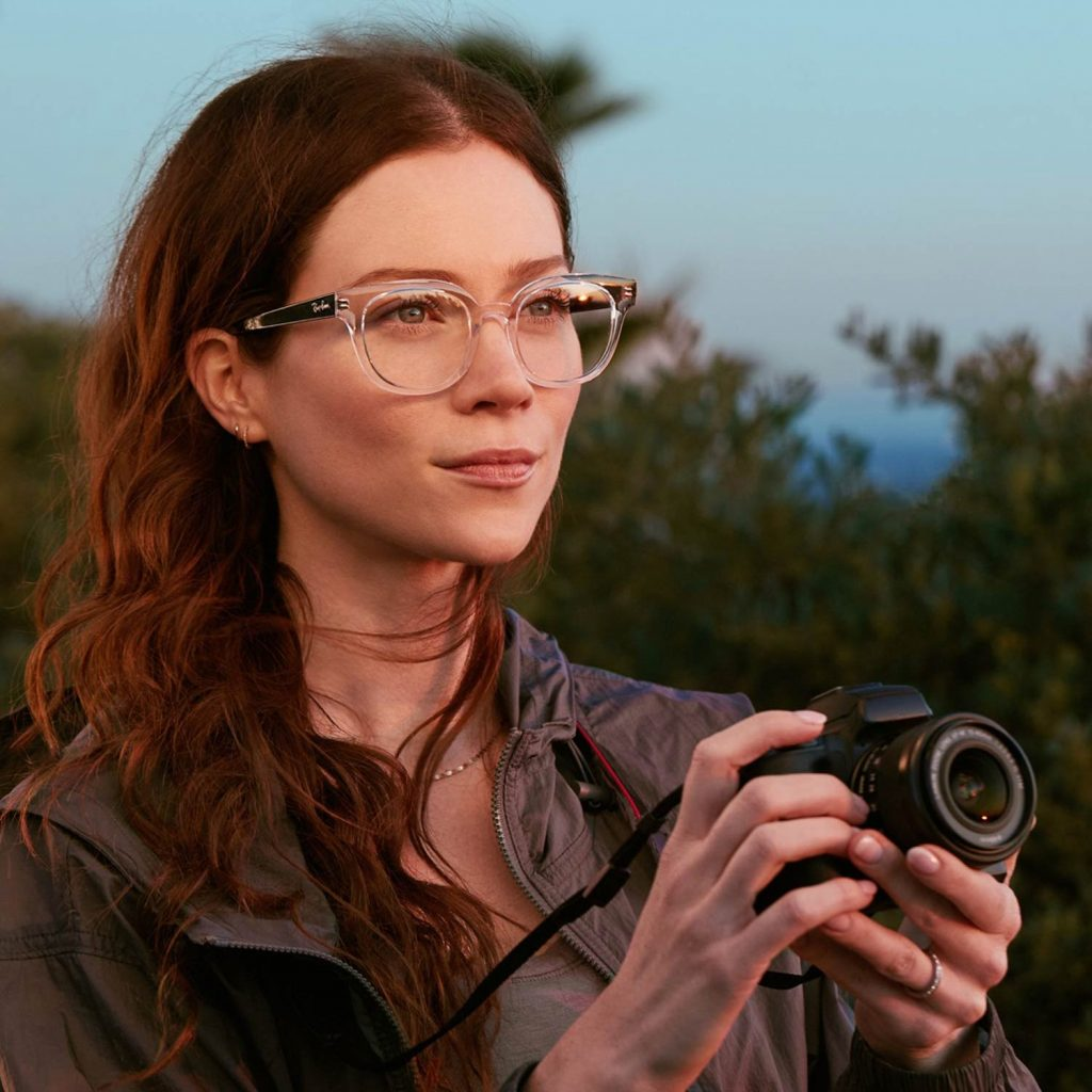 Image of Woman with Glasses with a Camera