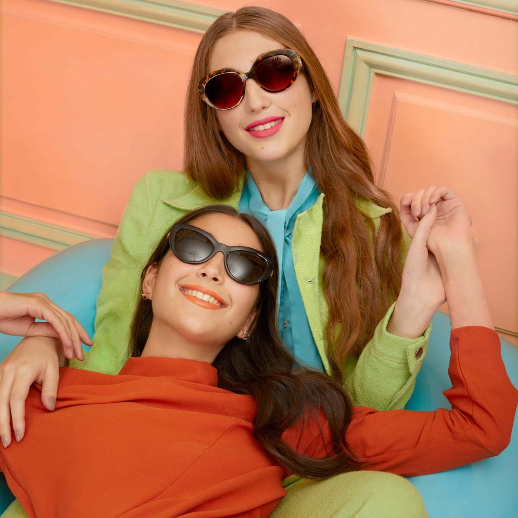 Image of Two Woman Wearing Designer Sunglasses