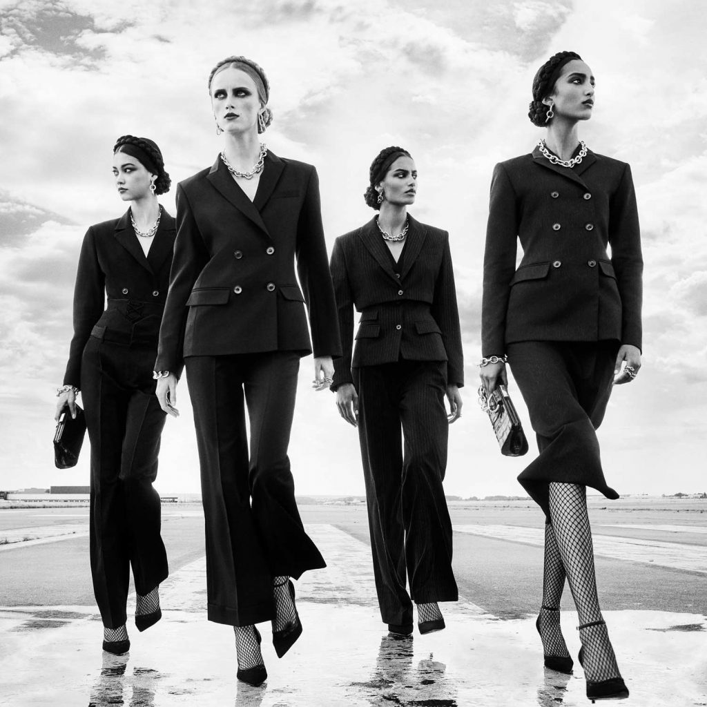 Image of Four Women in Black Suits
