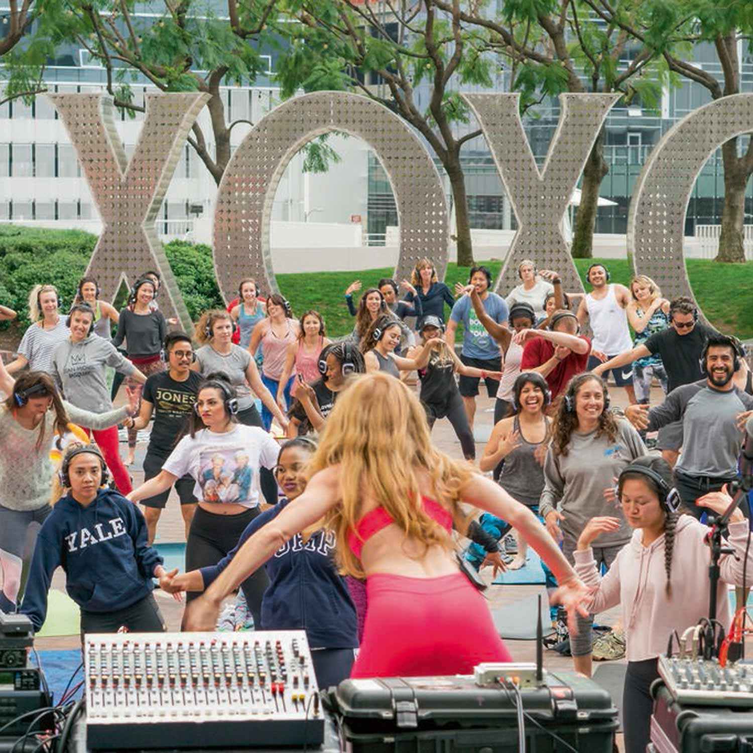 Image of Yoga Class in Front of Art Installation of Monumental Words